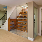 Wine cellar makes good use of space below stairs.